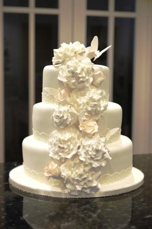 Simple Wedding Cake With Cascading Flowers - 3 Tier Wedding Cakes